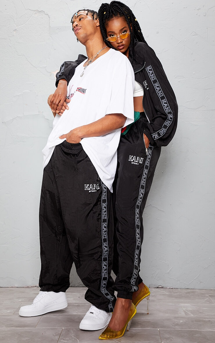 KARL KANI Black Tape Printed Shell Joggers